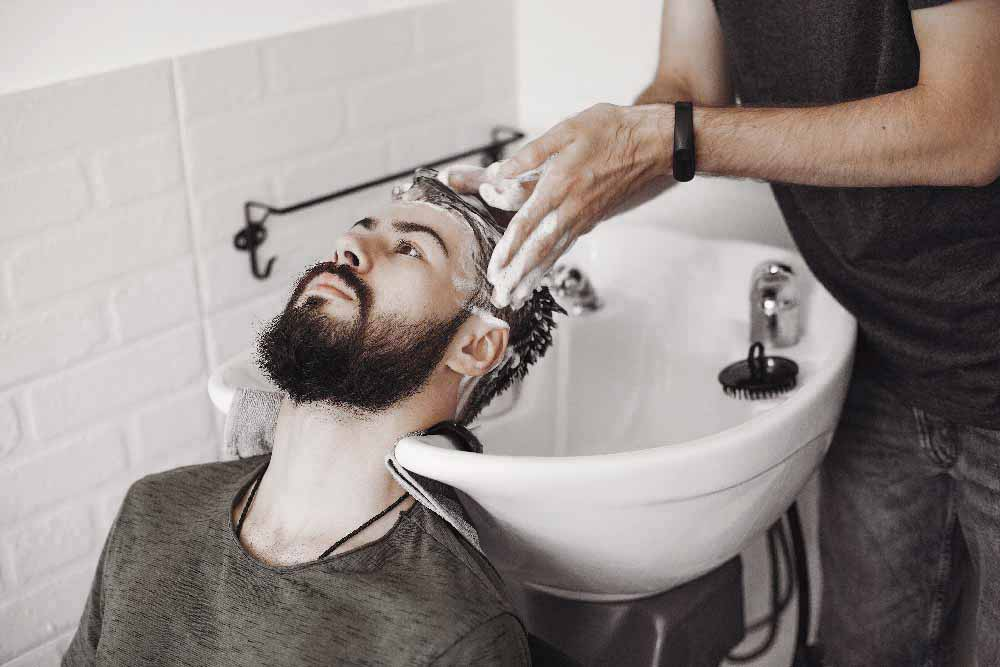 stylish-man-sitting-in-a-barbershop-98G645V