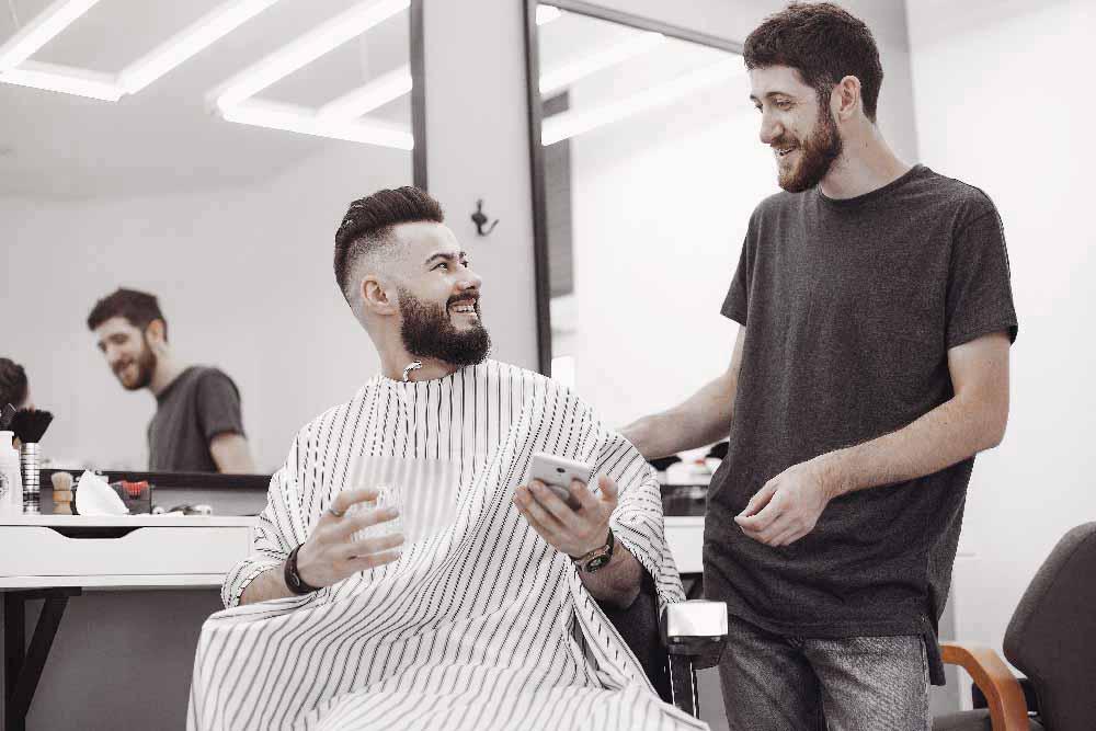 stylish-man-sitting-in-a-barbershop-CKF2KVB