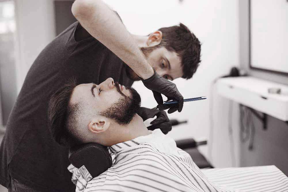 stylish-man-sitting-in-a-barbershop-U4YAVRL