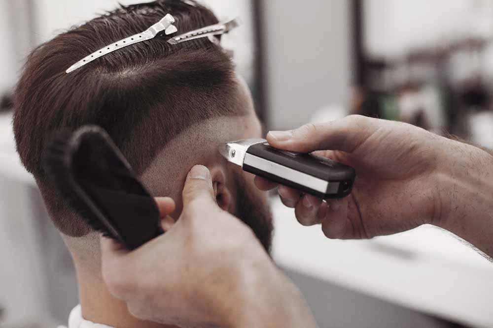 stylish-man-sitting-in-a-barbershop-Z7WU8LK